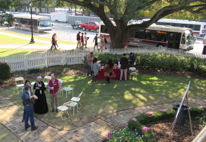a group of people standing in the yard of the Gorgas House